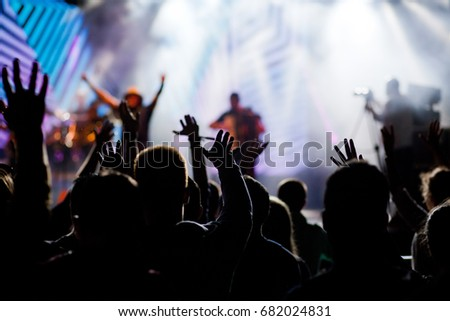 crowd with raised hands at concert - summer music festival #682024831