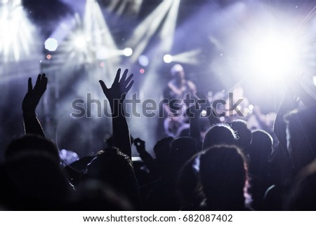 crowd with raised hands at concert - summer music festival #682087402