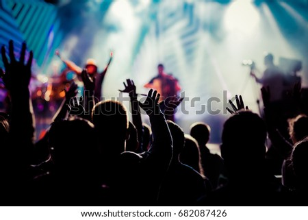 crowd with raised hands at concert - summer music festival #682087426
