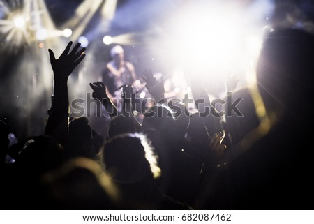 crowd with raised hands at concert - summer music festival #682087462