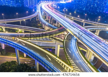 crowded cars driving at flyover,long exposure.