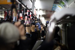 Crowded commuter train in Japan at rush hour in the evening.
