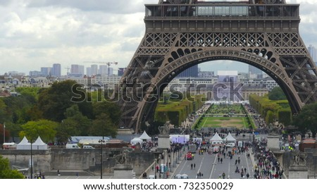 Crowded place near the Eiffel tower base and Champ de Mars in Paris, France Stock photo ©