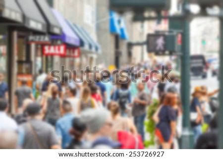 Crowded sidewalk on 5th Avenue with tourists. Blurred Background.