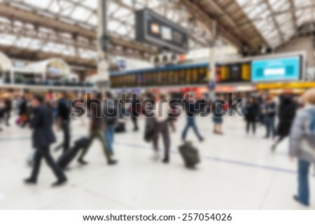 Crowded station during rush hour in London, blurred background