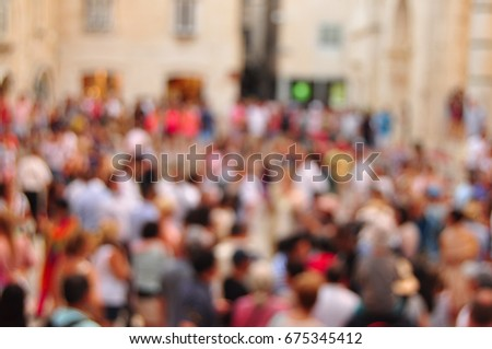 crowded street and blurred...