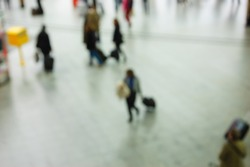 Crowded train station in Paris. Blurred photo. Abstract background.