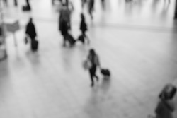 Crowded train station in Paris. Blurred photo. Abstract background. Black and white photo.