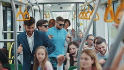 Crowded tram of funny passengers traveling through city. Group of happy multi-ethnic urban people dance having fun in public transport. Entertainment.
