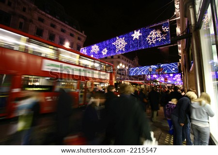 Crowds doing their festive shopping at a very busy Oxford Circus, central London, showing movement blur.