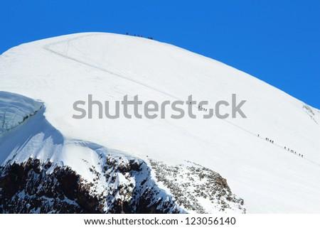 Crowds of climbers reaching the top of Breithorn, Zermatt, Switzerland