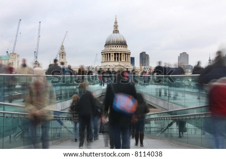 crowds on millennium bridge and st pauls cathedral in background, london
