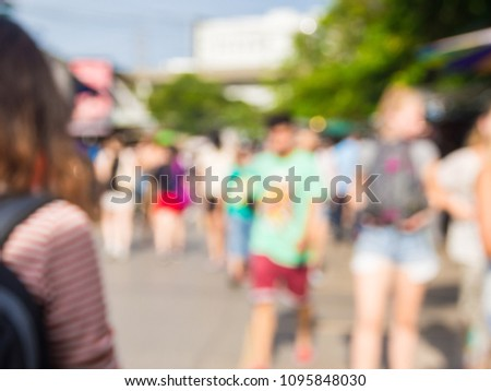 Crowed of anonymous business people walking on busy outdoor street in city #1095848030