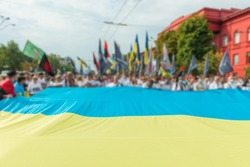 Crown of people with Ukrainian flag on March of defenders, parade in Kyiv, dedicated to the Independence Day of Ukraine, 29th anniversary
