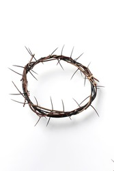 Crown of thorns isolated on white background. Top view. Copy space. Christian Easter concept. Crucifixion of Jesus Christ. He risen and alive. Jesus is the reason. Gospel, salvation.