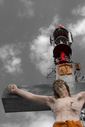 Crucified Jesus Crhist and a radio transmission tower on the Calvary (Kalvaria) hill in Szekszard, Hungary