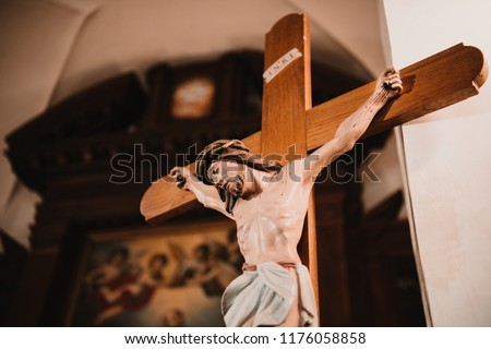 Crucifix, Jesus on the cross in church.  #1176058858