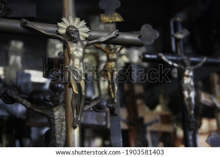 Crucifix of Jesus on the cross, on blurred background of group crucifixes. Symbol of religion and Christian faith.  Stock photo ©