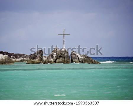 Crucifix on rock formation, Port Launay Marine National Park, Mahe', Seychelles