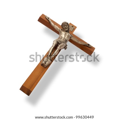 Crucifix with figure of Jesus on white background, horizontal with shadow