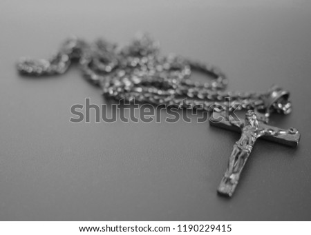 crucifixion from a tree Jesus's gilt figure black and white image with copy space for text