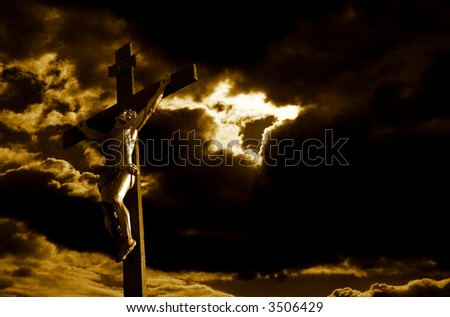 crucifixion of Jesus Christ with dramatic sky in background