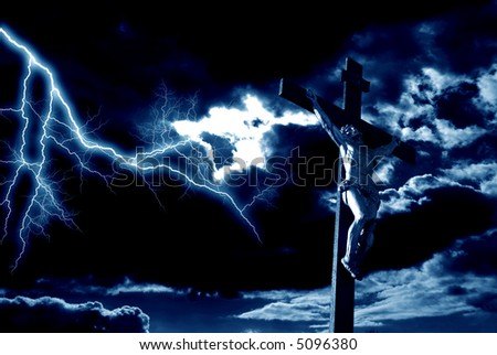 crucifixion of Jesus Christ with dramatic sky in background and lighting