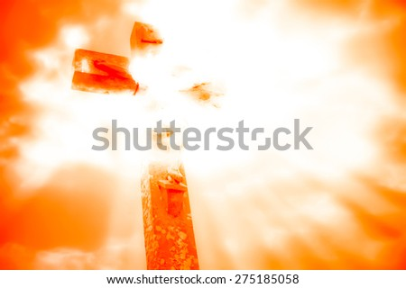 crucifixion of Jesus with dramatic sky background