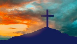 crucifixion, religion and christianity concept - silhouette of cross on calvary hill over sky background