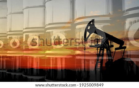 Crude mining concept and graph of falling oil prices on the trading exchange. Crude oil pump jack at oilfield on sunset backround. Fossil crude output and fuels oil production. Oil drill rig Stockfoto ©