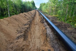 Crude oil and Natural gas pipeline construction work in forest area.  Installation the Petrochemical Pipe. Construction the Pipeline for transport gas to LNG plant