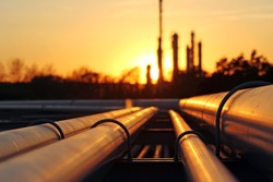 crude oil refinery during sunset with pipeline connection