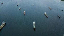 Crude oil tanker and LPG  Loading in port at sea view from above. Aerial view oil tanker ship shot from drone.