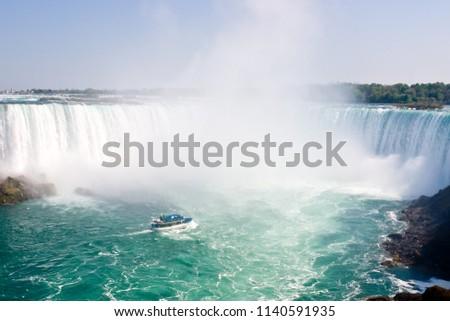 Cruise Boat and Horseshoe Falls from Niagara Falls - Ontario, Canada #1140591935