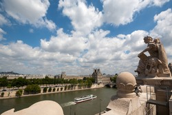 Cruise boat on the River Seine in Paris viewed from atop of the Museum De Orsay