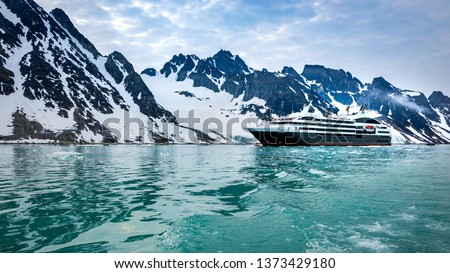 Cruise expedition ship bow passing icy snow arctic waters near Spitsbergen,  Norway #1373429180