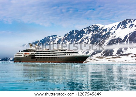 Cruise expedition ship bow passing icy snow arctic waters near Spitsbergen, Svalbard, Norway Сток-фото ©