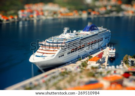Cruise liner in Kotor bay near the old city. Top view from the mountain - stock photo