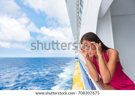 Cruise sea motion sickness tourist woman seasick on boat vacation with headache or nausea. Fear of travel or illness virus on cruising holiday. #708307675
