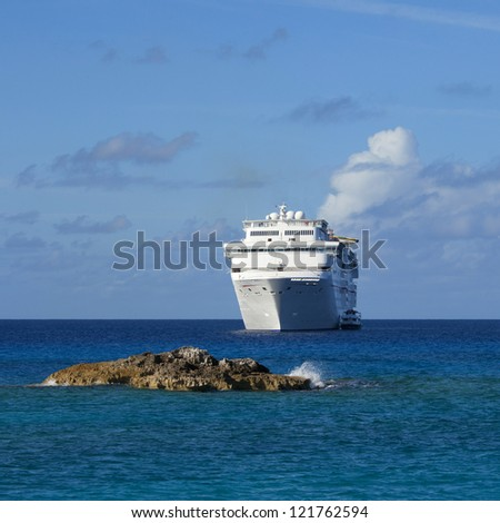 cruise ship anchored off the coast of the bahamas