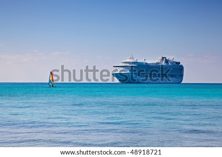 Cruise Ship and Sailboat in Caribbean