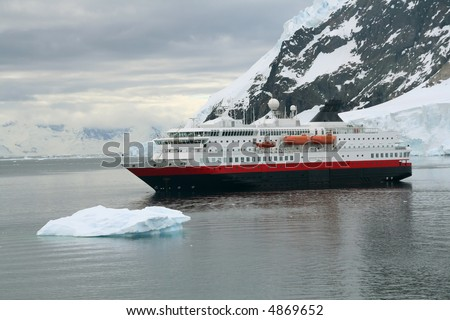 Cruise ship at anchor with glaciers and icebergs,		Neko Harbor, Andvord Bay,	Antarctica