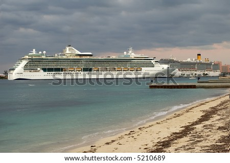 Cruise ship at dock with dark sky after a storm.