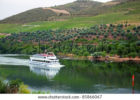 Cruise ship at Foz do Tua, Douro Valley, Portugal, with the Port wine vineyards in the background