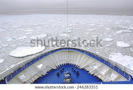 Cruise Ship bow passing icy snow arctic waters near Spitsbergen, Svalbard, Norway