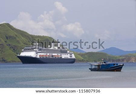 Cruise ship & fishing boat at anchor in Komodo Island Bay, Indonesia