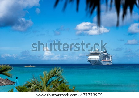 Cruise ship in crystal blue water with blue sky #677773975
