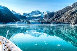 Cruise ship in Glacier Bay cruising towards Johns Hopkins Glacier in Alaska, USA. Panoramic view during summer.