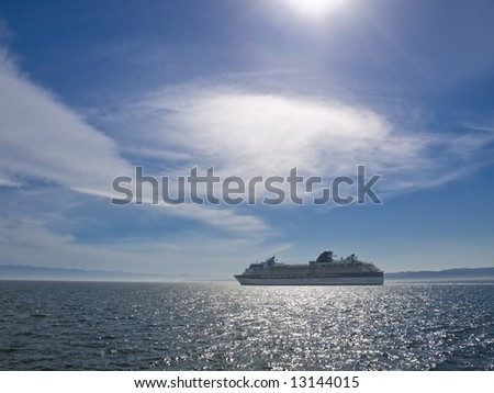 Cruise ship in the ocean lit by the sun