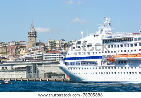 cruise ship is moored near the Galata Tower of Istanbul, Turkey
